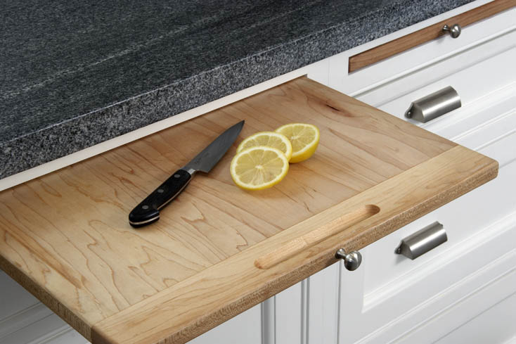 cutting board in white kitchen